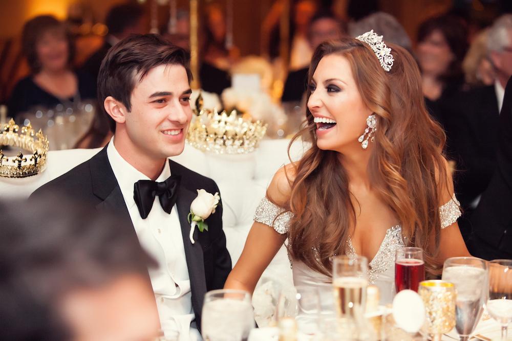 Bride in Tiara Laughing at Reception