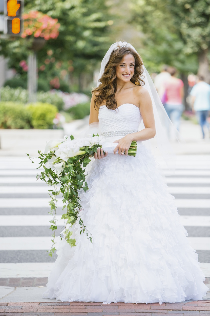 Cascading white flower bouquet with bride