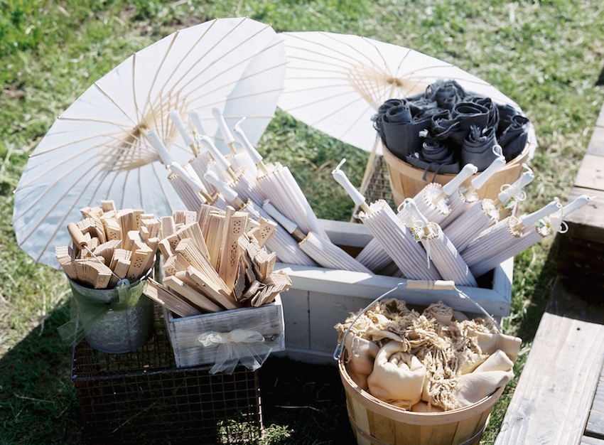 Parasols and Fans on Display in Grass