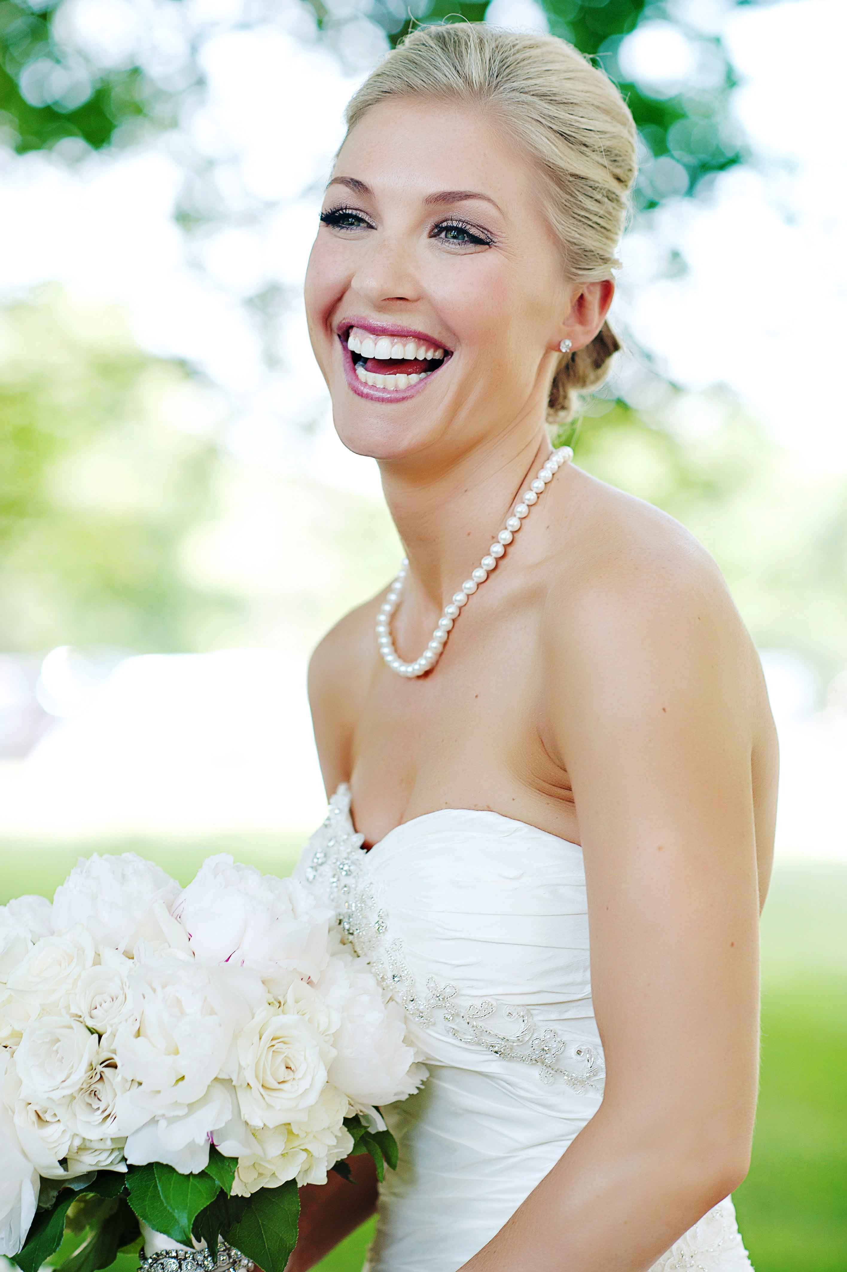 Bride Smiling with Pearl Necklace