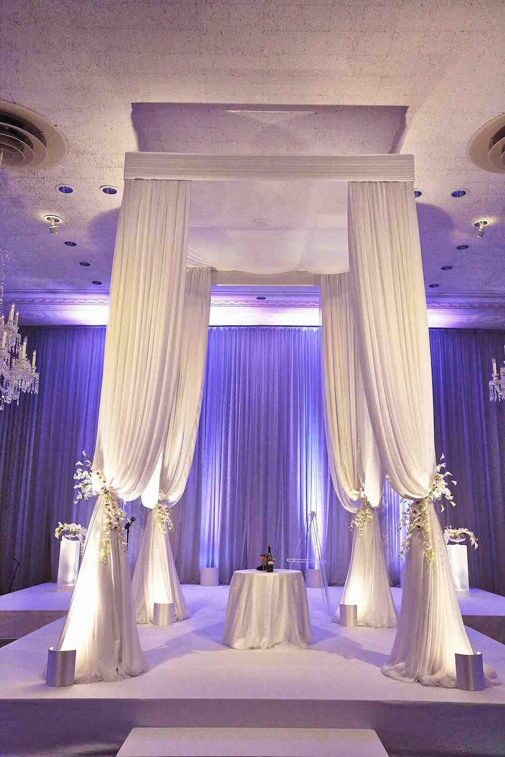 Purple and White Indoor Wedding Ceremony