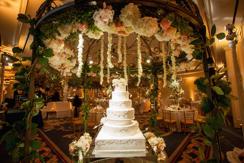 White cake in forest ballroom wedding