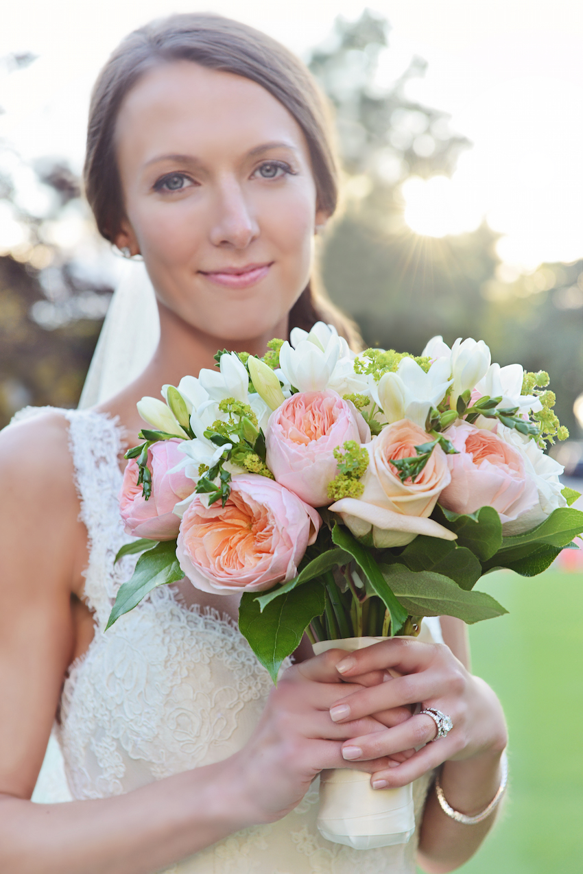 Bride holding bouquet with pink garden roses