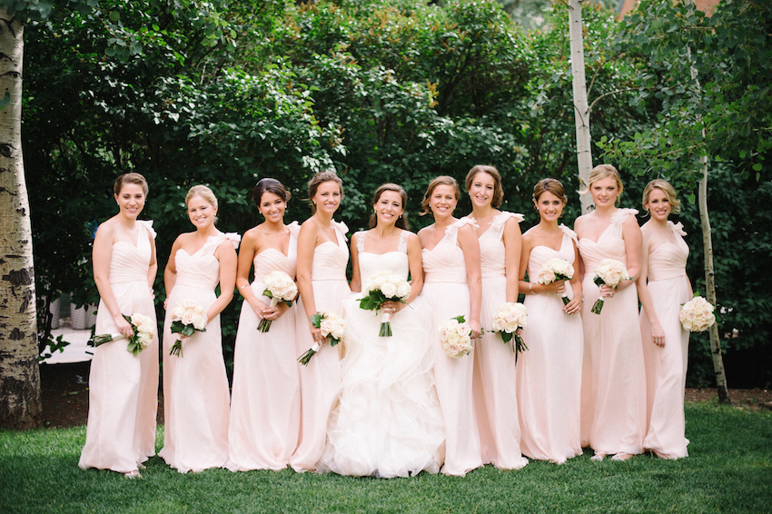 Happy bridesmaids in pink dresses