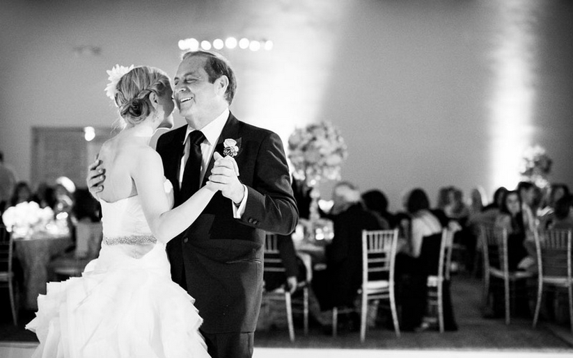 Black and white photo of father-daughter dance at wedding