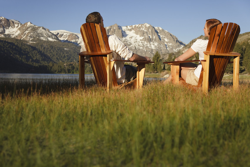 Bride and groom on lawn chairs in Mammoth Lakes