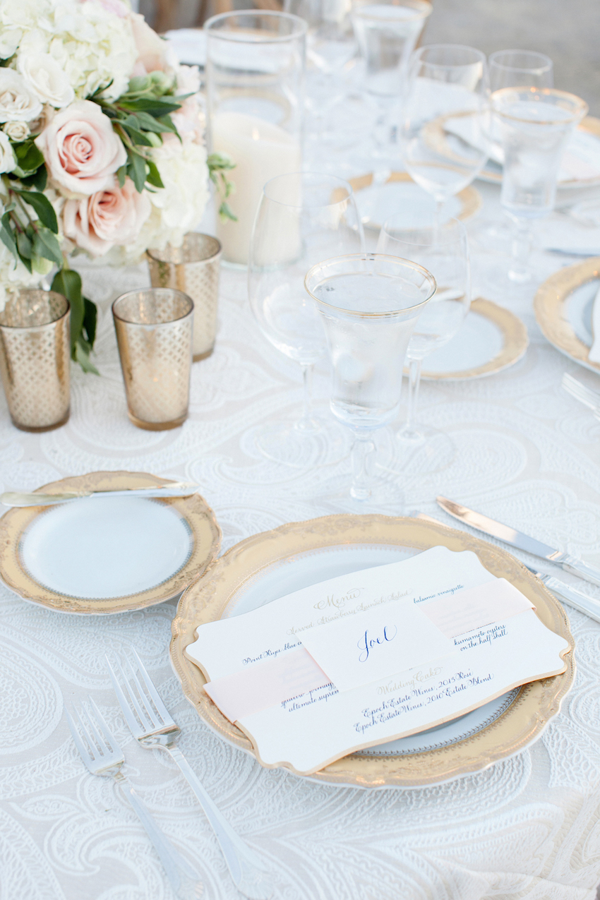 Gold rimmed glassware and charger at wedding