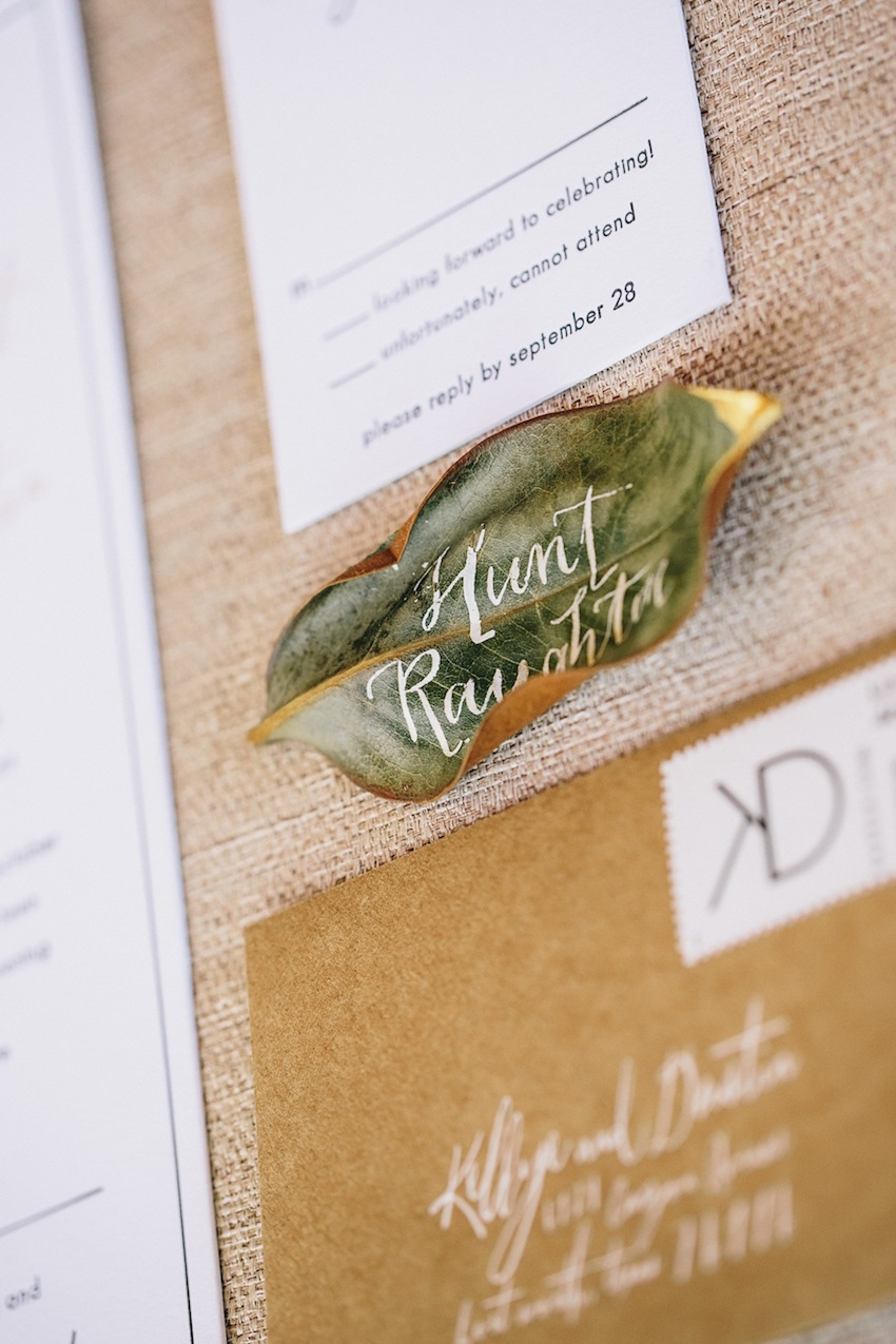 Leaf escort cards with gold dip and calligraphy