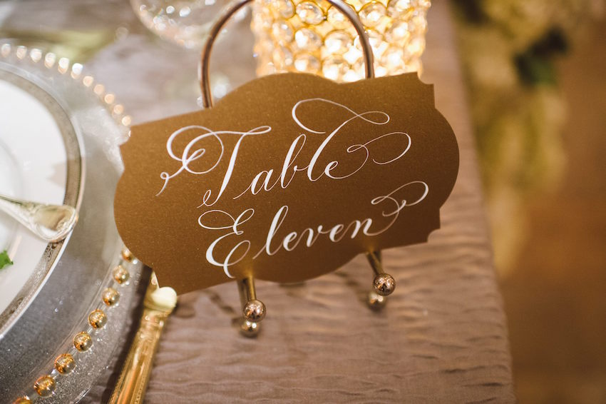 Gold die cut table name card with calligraphy