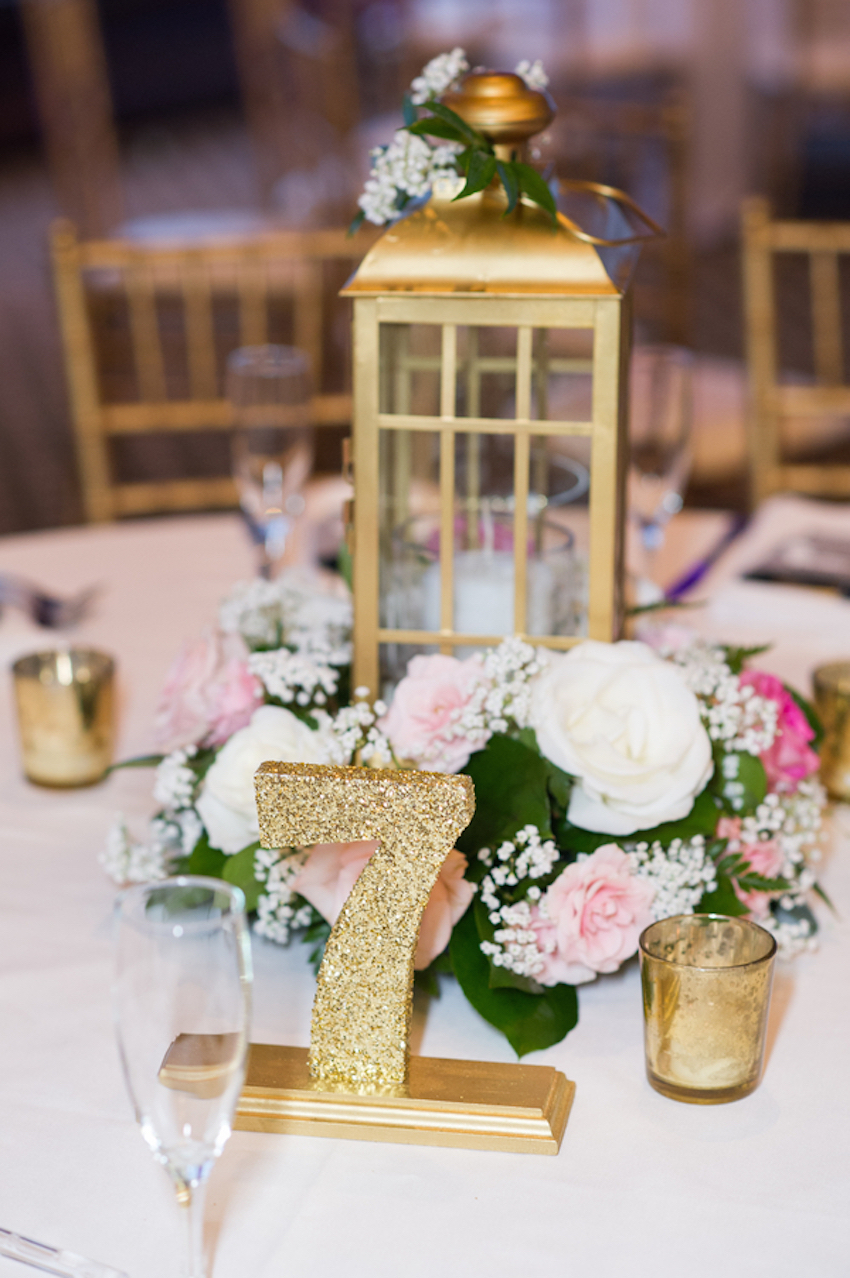 Gold glitter standing table number at wedding