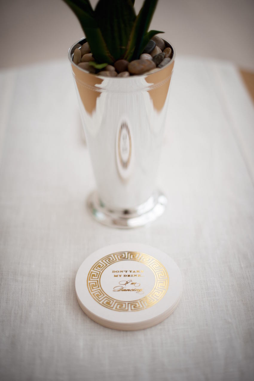 Gold Foil on drink coaster at wedding cocktail hour