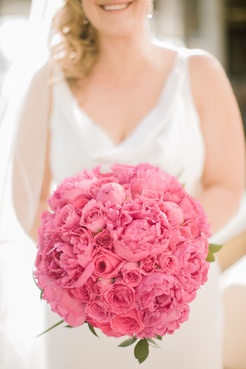 Bride holding pink peony wedding bouquet