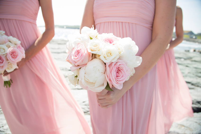 Light pink bridesmaid dresses and bouquets