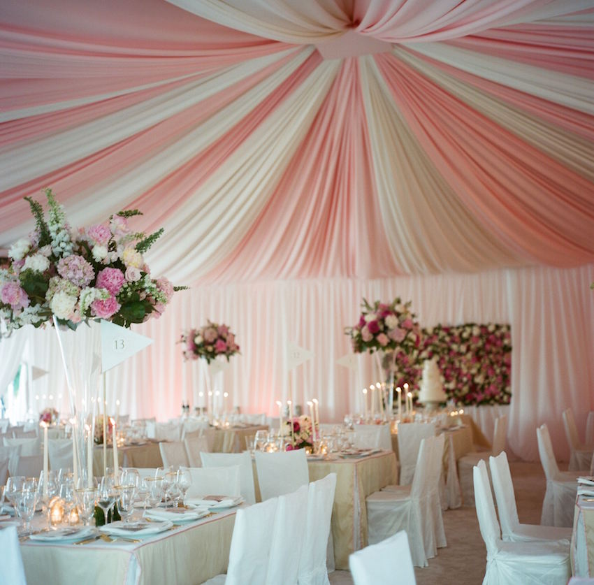 Pink and white stripe wedding reception tent