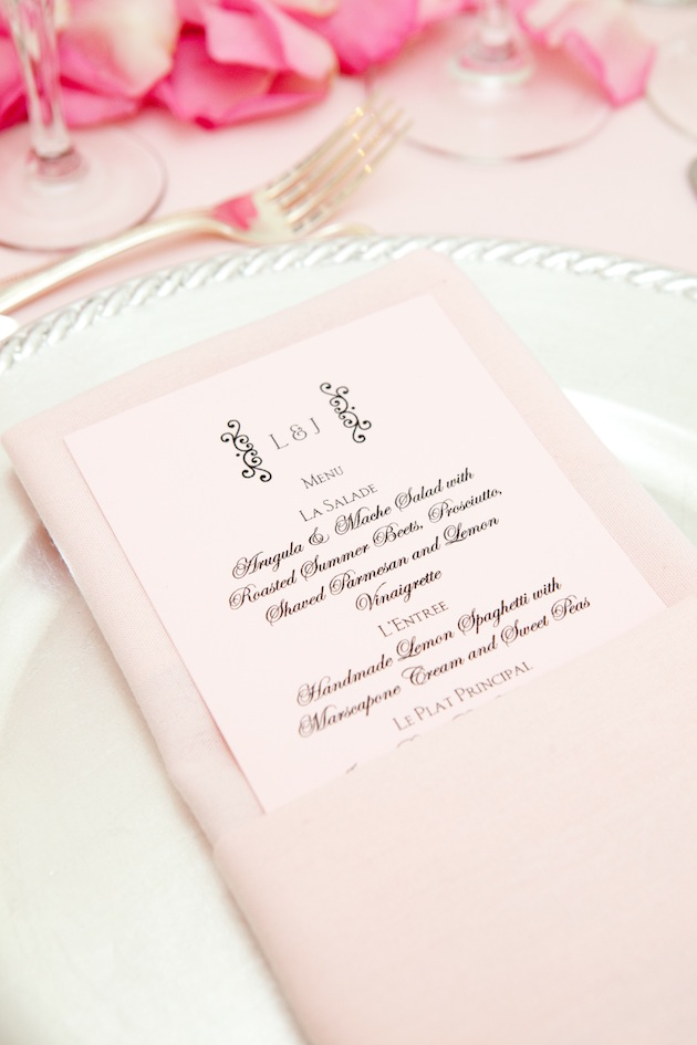 Pink wedding menu with black lettering