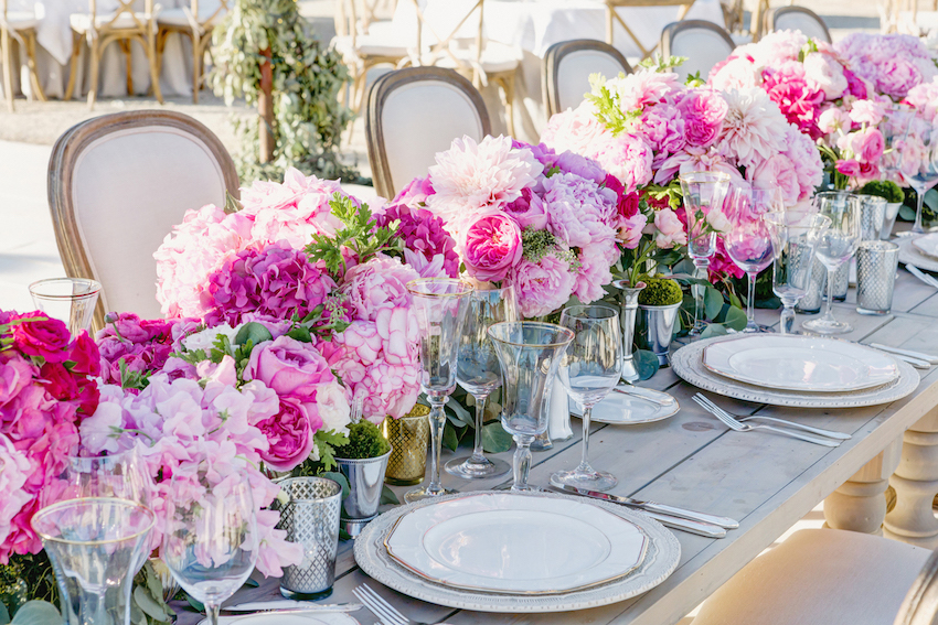 Pink flower table runner at wedding reception