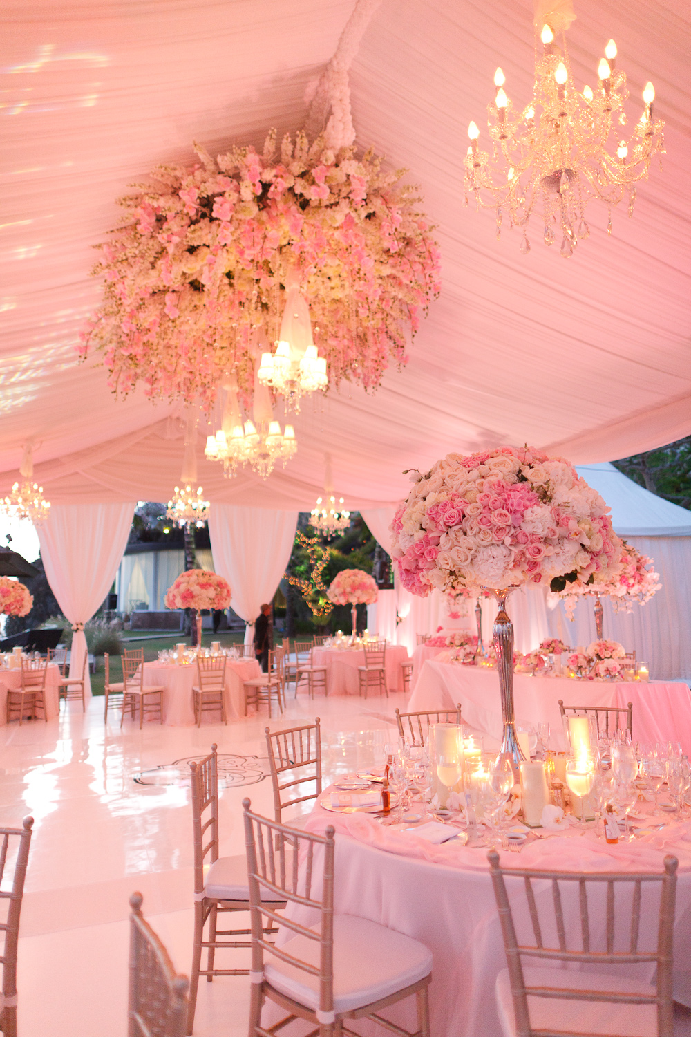 Pink tent wedding with flower chandelier