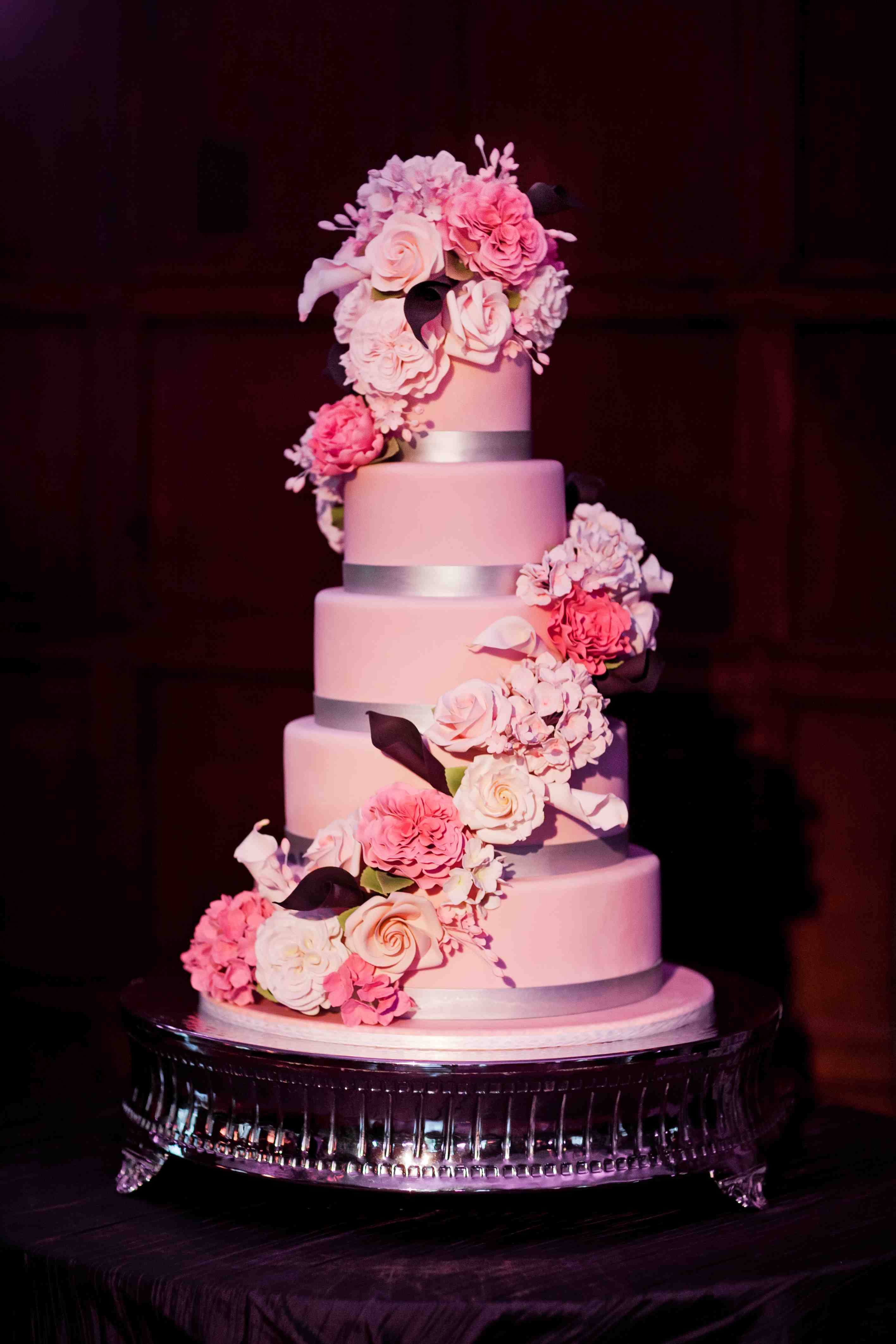 Pink wedding cake with sugar flowers