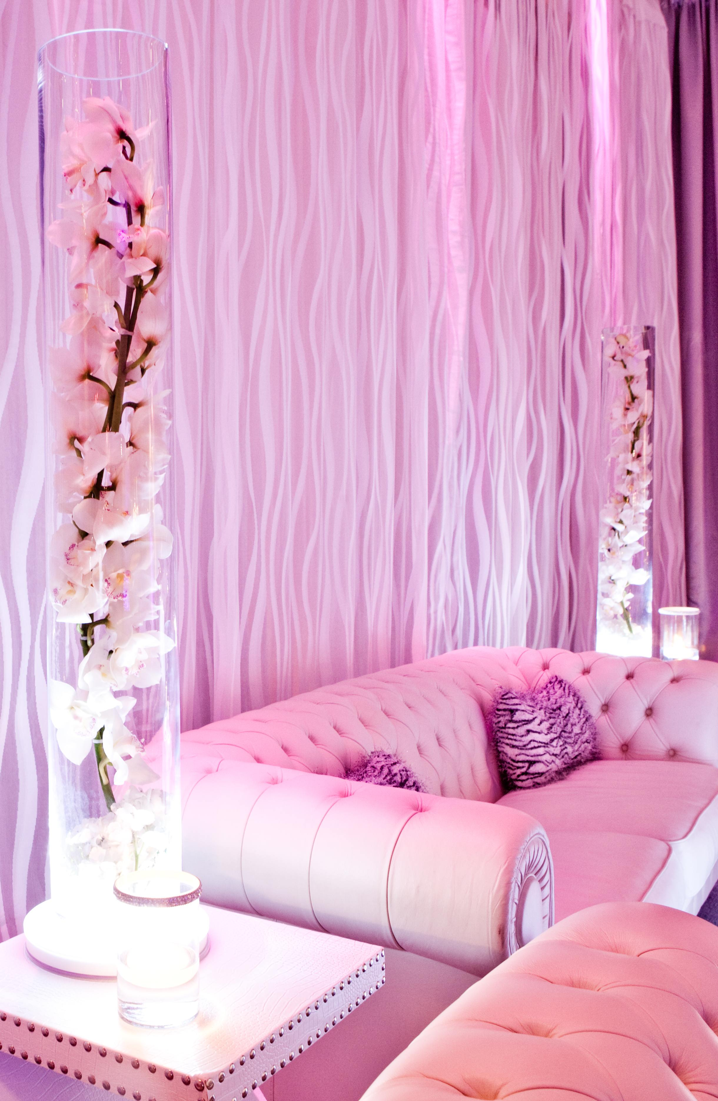 Pink lighting on tufted after party decorations