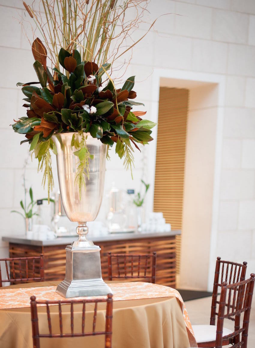 Magnolia and cotton Southern wedding centerpiece