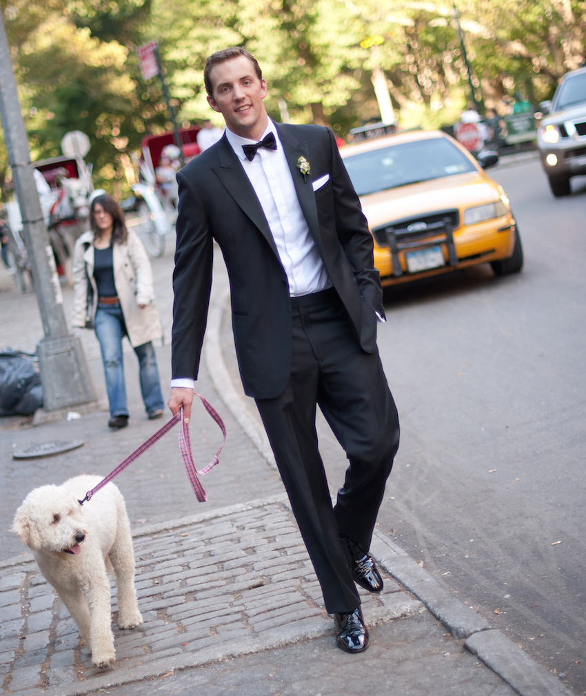 Groom in tux walking dog in New York City