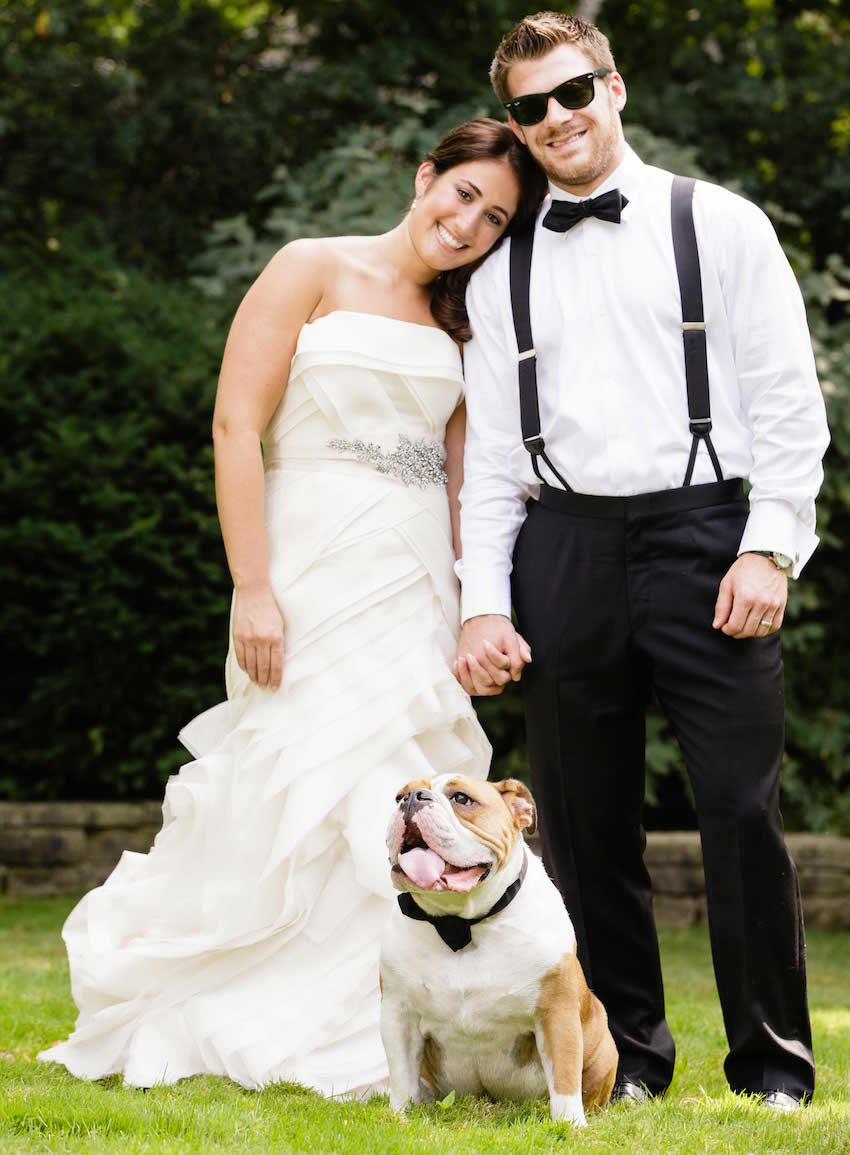 Bride and groom with bull dog at wedding