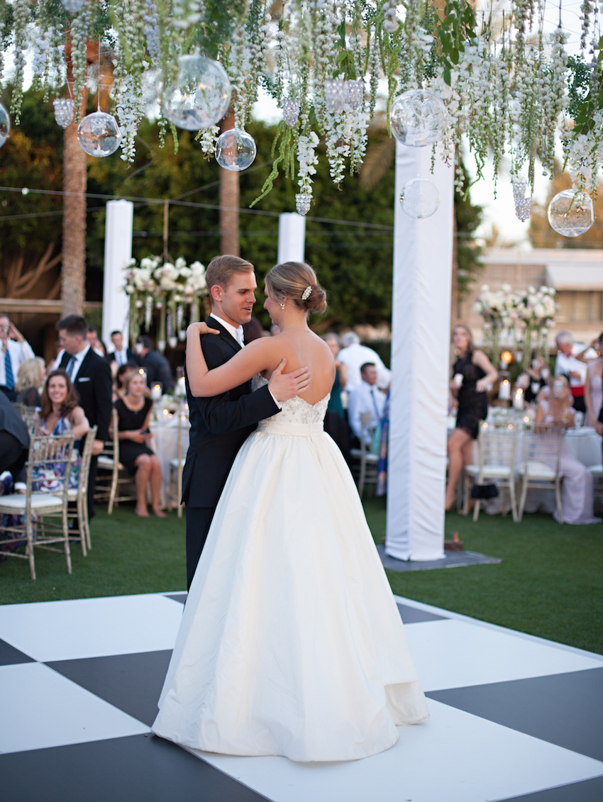 Bride and groom first dance on checkers