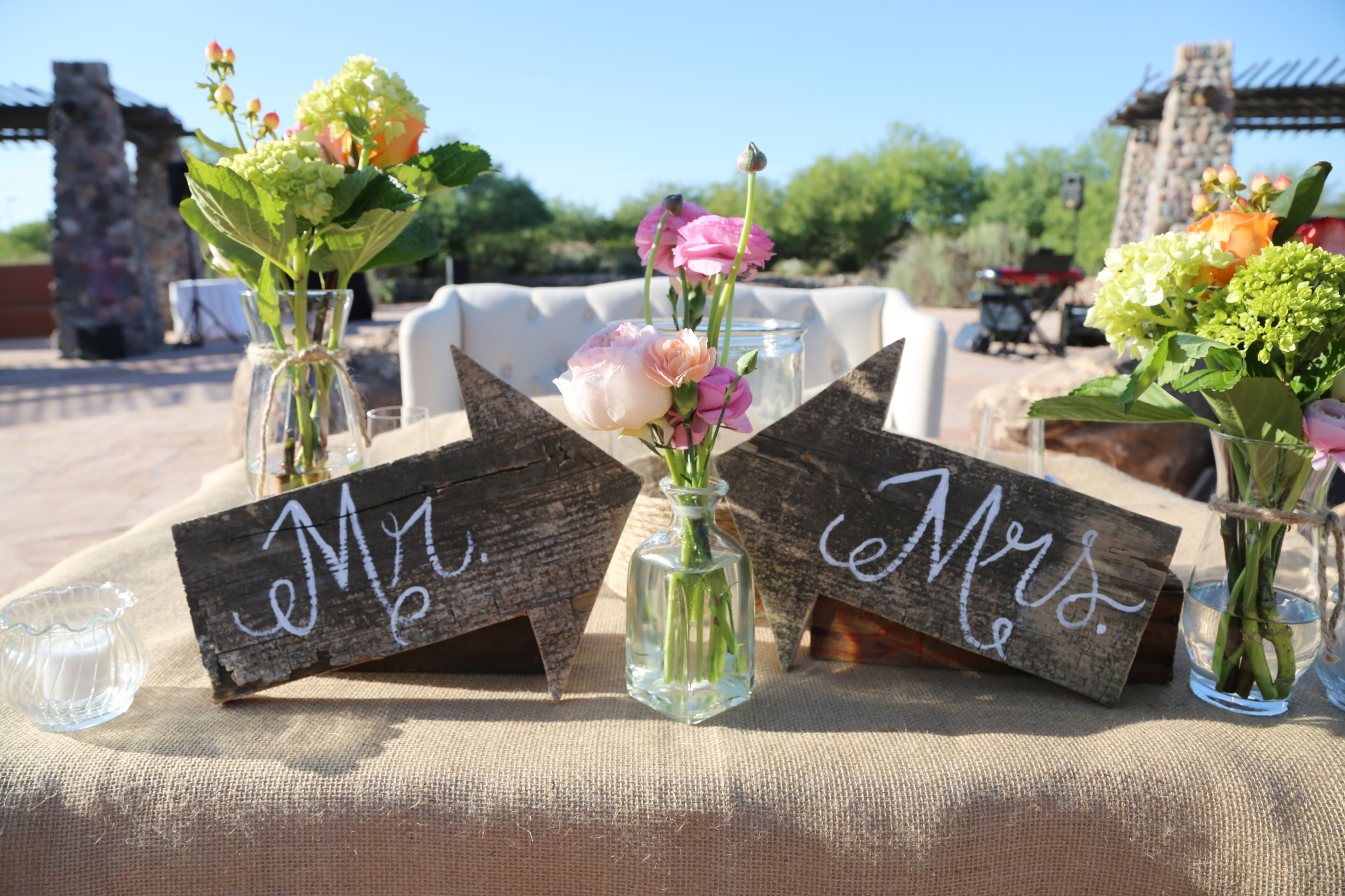Mr. and Mrs. wood signs at wedding reception