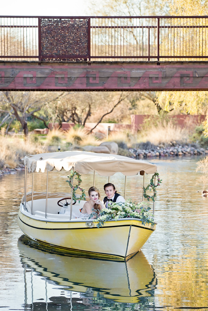 Bride and groom on lake in row boat