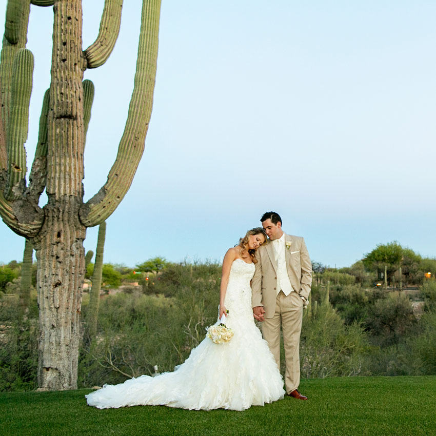 Bride and groom with Saguaro cactus