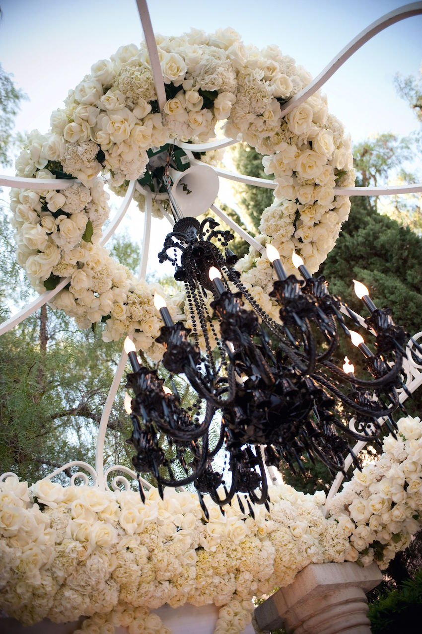 Black chandelier with white rose decorations