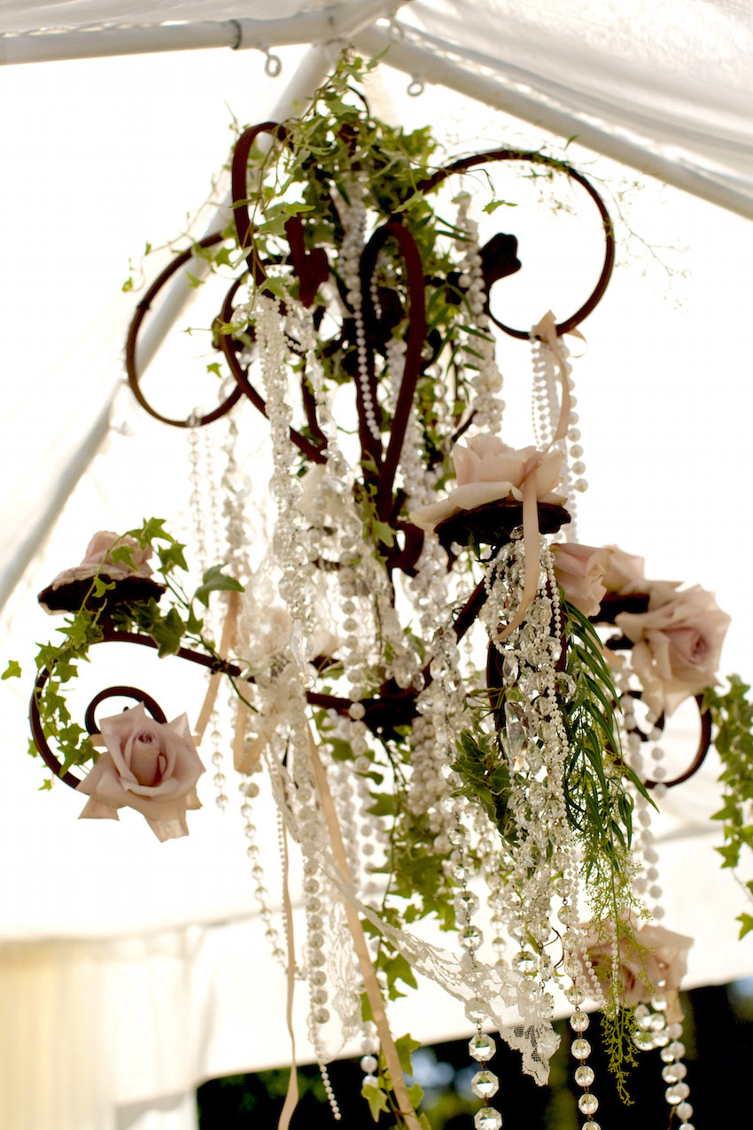 Wrought iron chandelier with pink and white roses