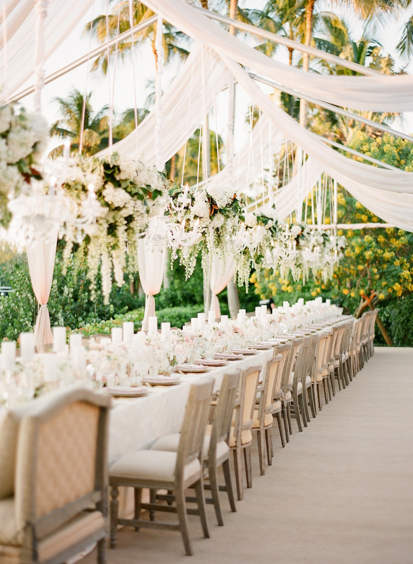 Pretty draping wedding reception with floral chandelier