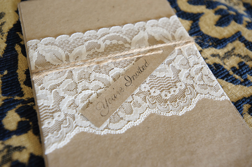 Rustic invitation with white lace and twine