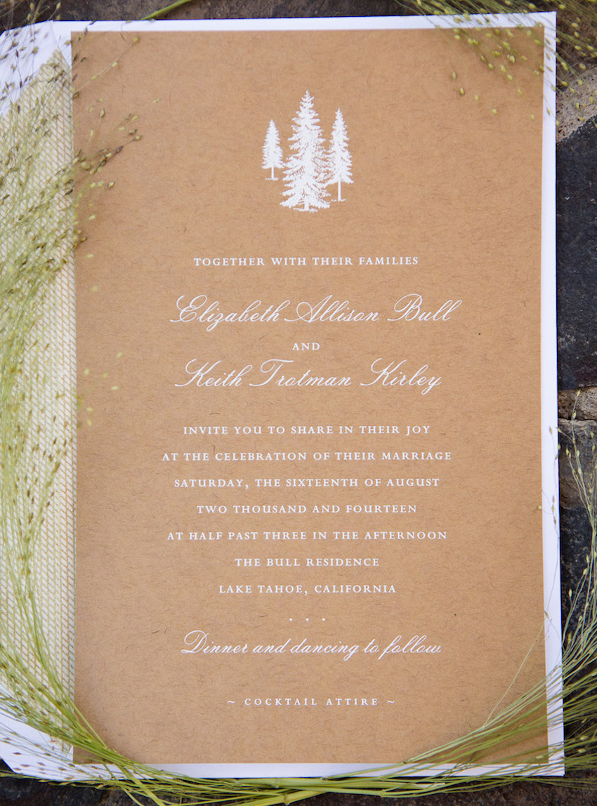 Rustic wedding invitation on kraft paper with white ink
