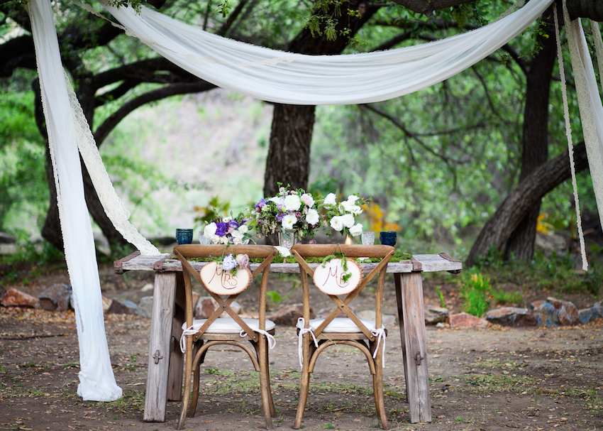 Rustic outdoor wedding sweetheart table idea
