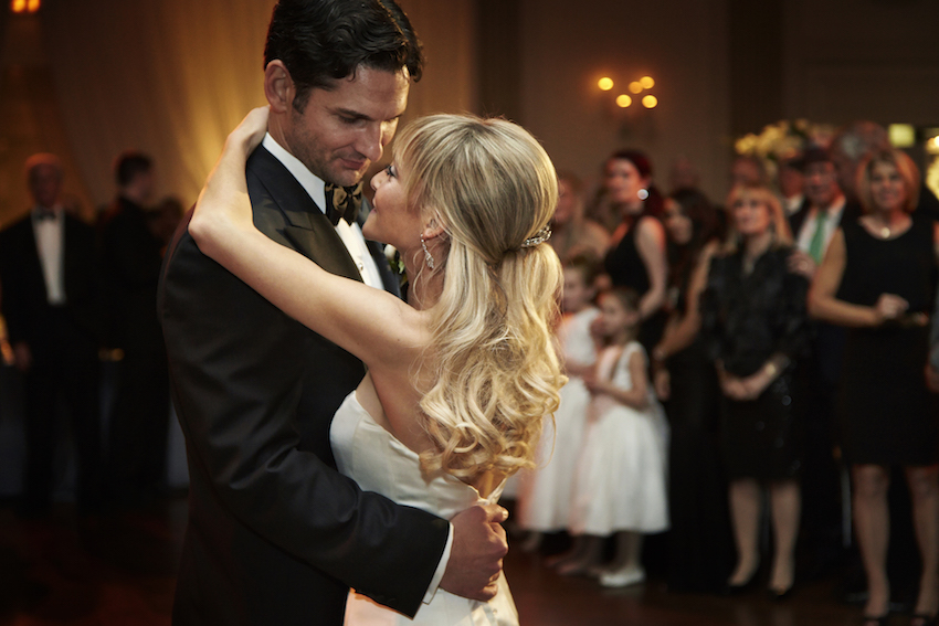 Blonde bride dances with groom first dance