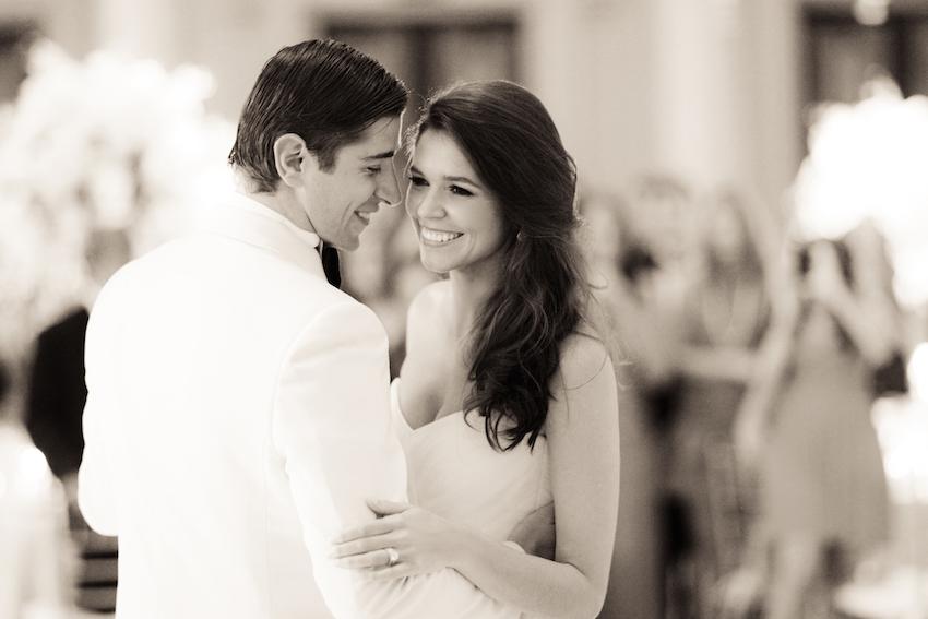 Black and white photo of model couple on dance floor