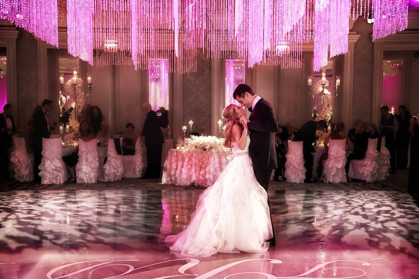 Pink lighting on wedding reception dance floor
