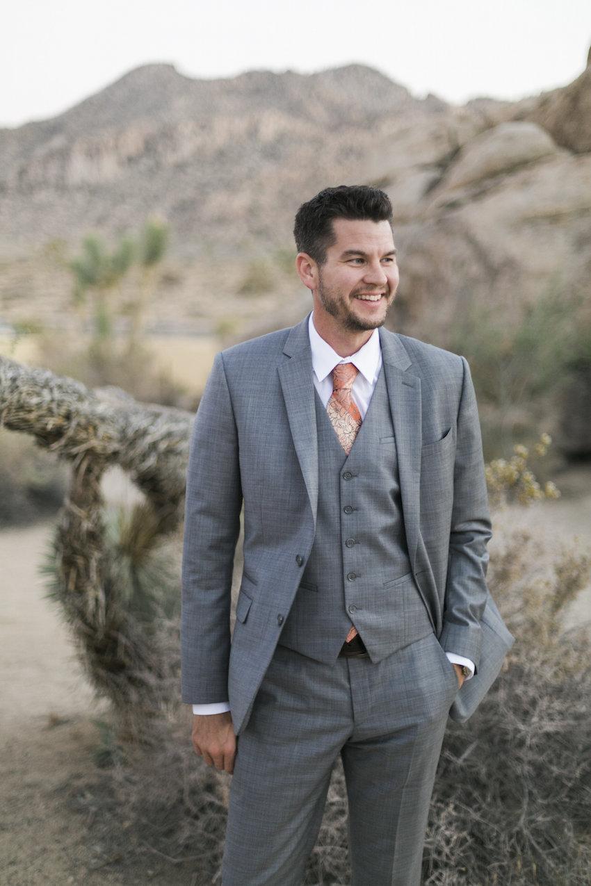 Groom in three piece grey suit engagement shoot attire