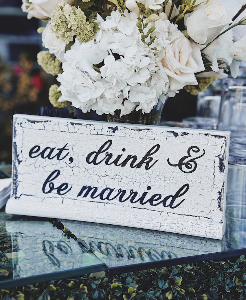 Brittney Palmer Aaron Zalewski wedding bar sign