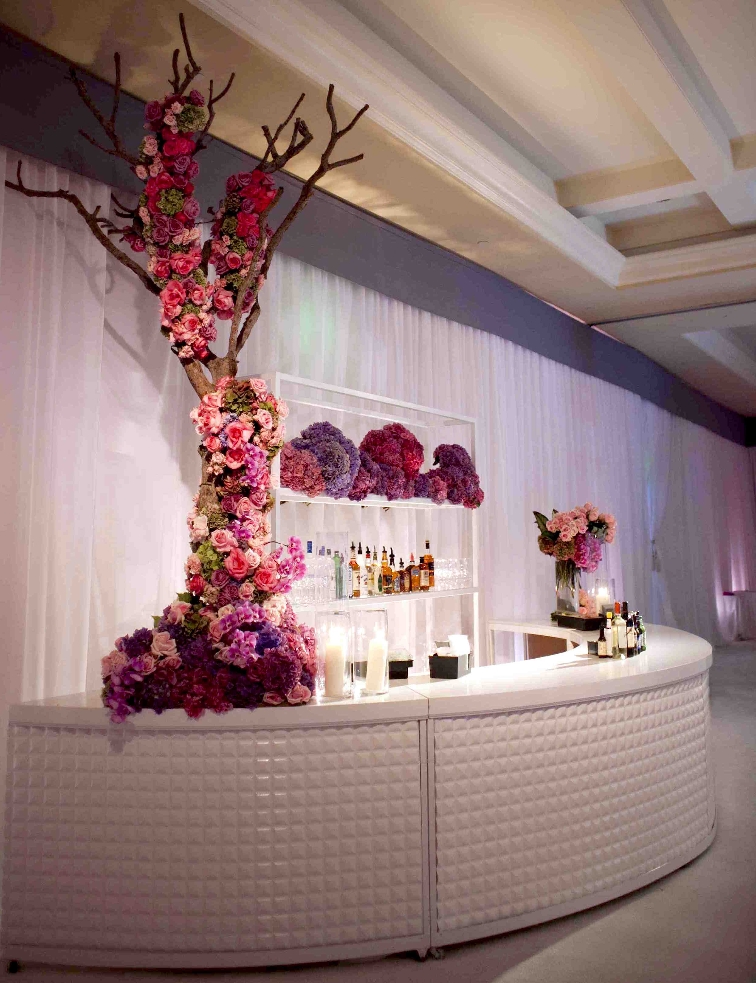 White tufted wedding bar with flowers