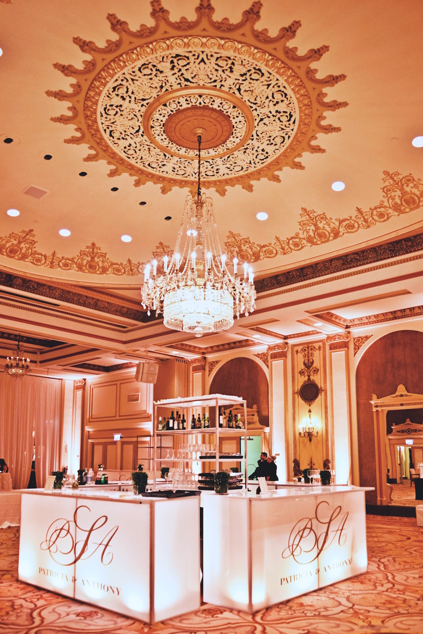 Gold and white ballroom wedding bar