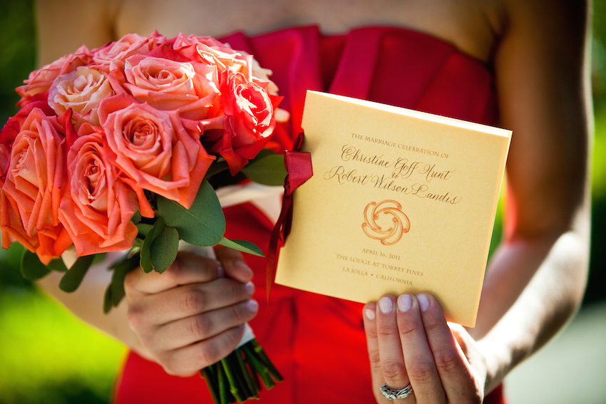 Bridesmaid holding program and bouquet