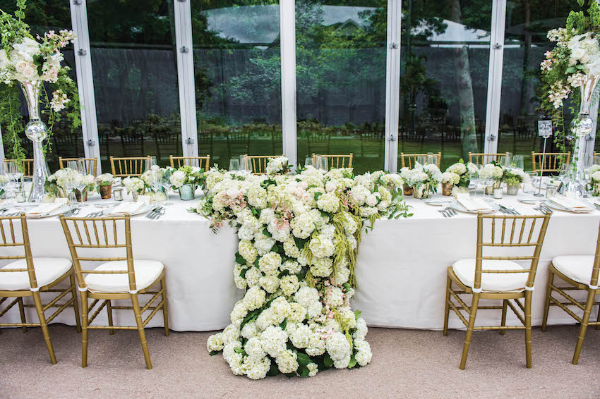 Reception table with flowers overflowing