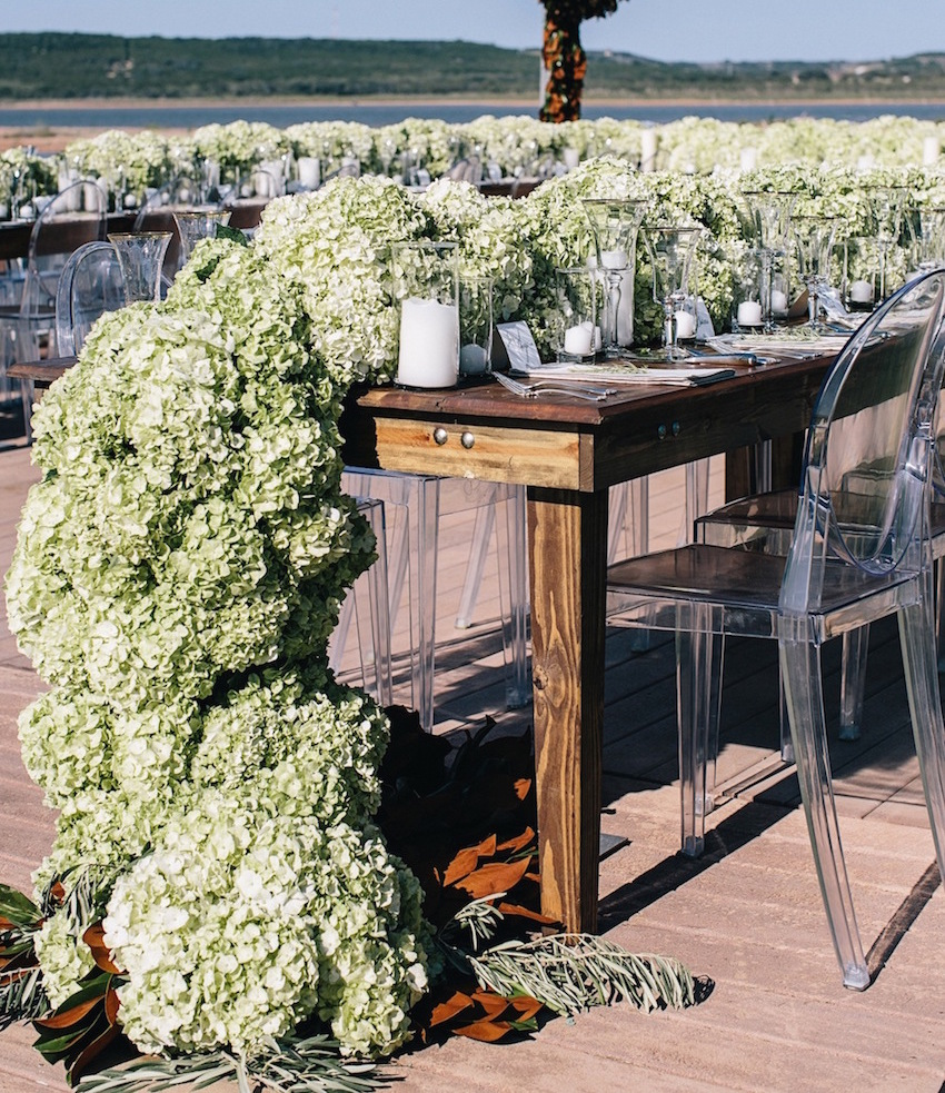 Green hydrangea table runner at rustic wedding