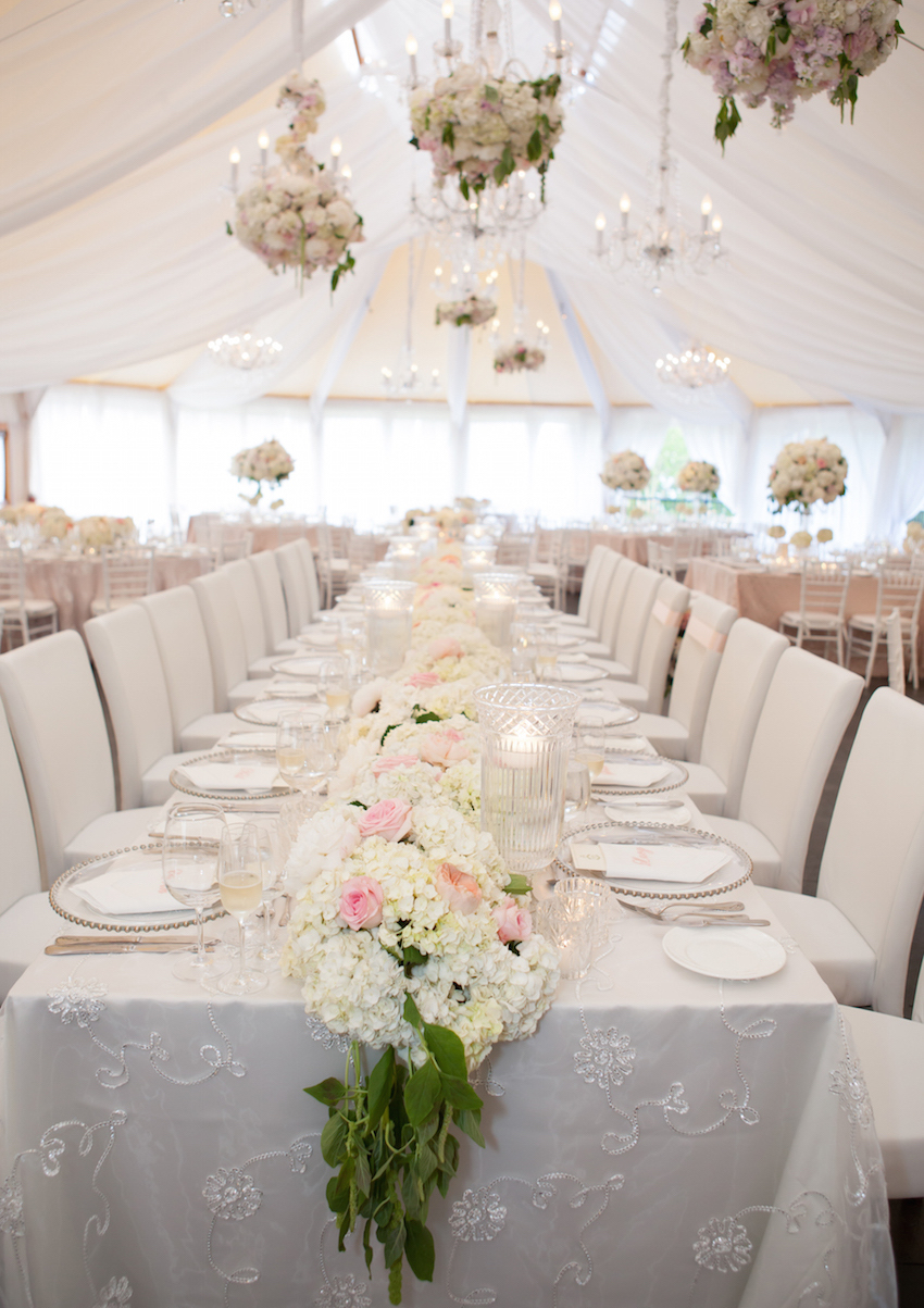 Flower table runner at tent wedding