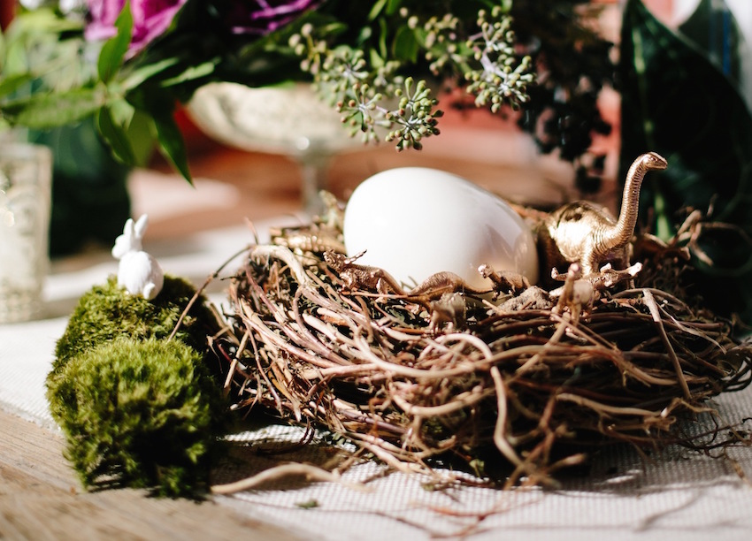 Egg and gold dinosaur in nest at wedding