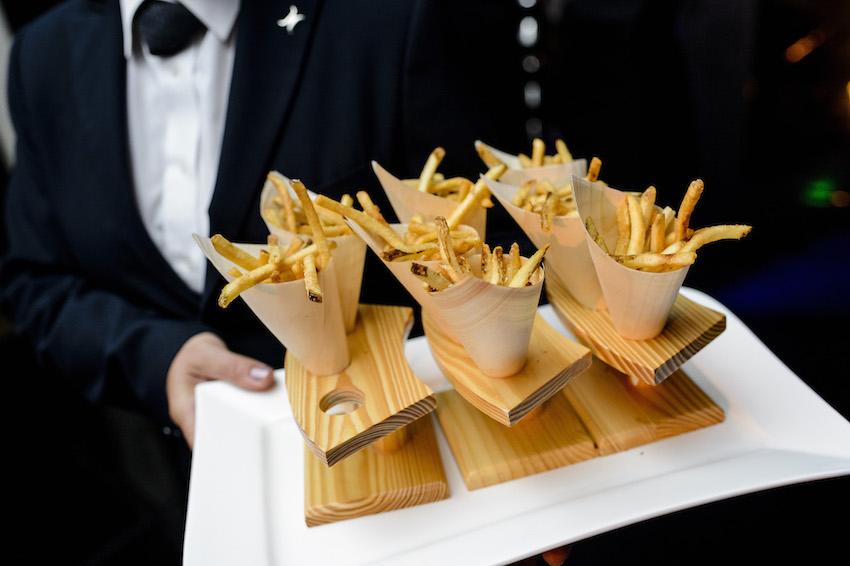 Wedding snacks french fries on wood tray