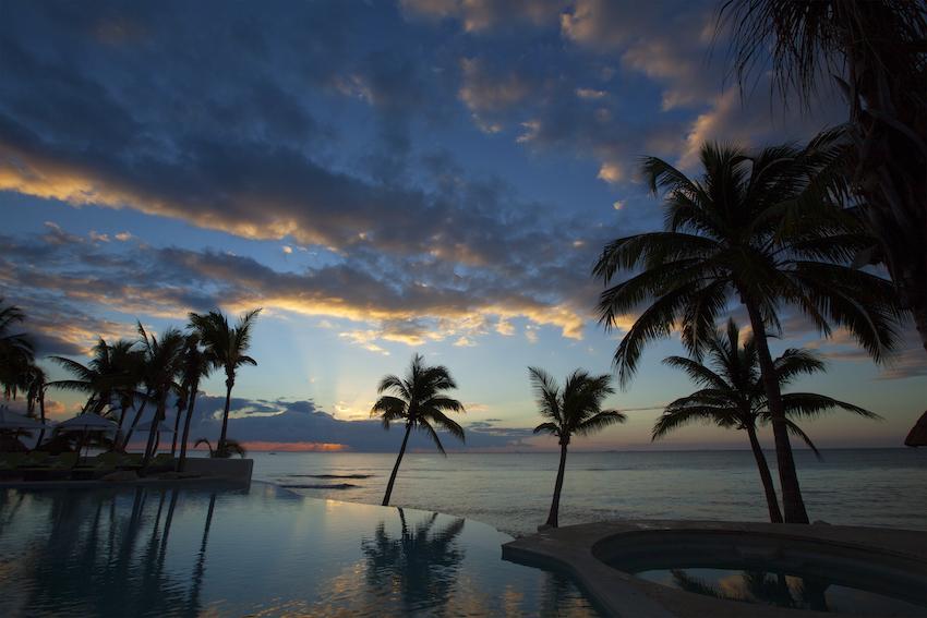 Sunrise over pool at Mahekal Beach Resort